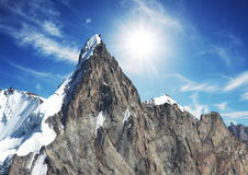 Sun and snow in mountain stock photo