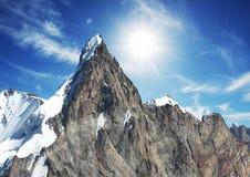 Sun and snow in mountain Royalty Free Stock Photos