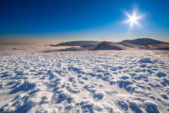 Sun and snow mountains landscape Royalty Free Stock Photography