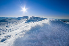 Sun and snow mountains landscape Royalty Free Stock Photos