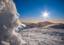 Sun and snow mountains landscape Royalty Free Stock Photo