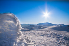 Sun and snow mountains landscape Royalty Free Stock Images