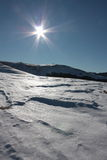 Sun and snow in  the Pyrenees. Sun and snowy mountain in Pyrenees,Aude,Languedoc region of France Royalty Free Stock Photo