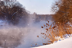 Sun and snowflakes. Sunny winter morning on a river. Sunny winter morning on a river Svisloch, Belarus Stock Photo