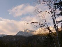 Sun on snowy bluff Stock Photo