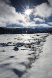 Sun and snowy landscape in Pyrenees Royalty Free Stock Photos