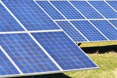 Sun and solar panels in a field. Solar energy power plant. Industrial and ecological concept for nature and eco / green technology Stock Images