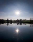 Sun sopra il lago Fotografia Stock