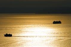 Sun Splashed. Two ferry boats on Elliott Bay in Seattle,wa Royalty Free Stock Photo