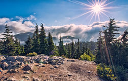 Sun Star Above Cloud On Mountain Top Royalty Free Stock Photos