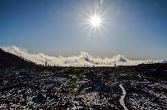 Sun Star on a Blue Sky over a Mountain Silhouette. In Gran Canaria Spain Stock Images