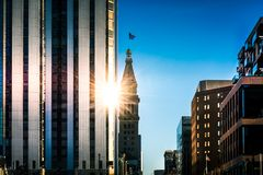 A sun star peeking through in Denver. Evening sun peeks and reflects through two buildings in downtown Denver Colorado royalty free stock images