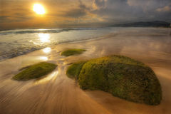 Sun, stone and sand of Karon Royalty Free Stock Images