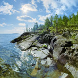 Sun and stony shore of Ladoga lake Royalty Free Stock Photos