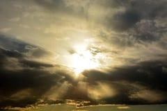 Sun through the stormy clouds Stock Photos