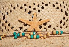 Sun straw hat with beads and decoration starfish Royalty Free Stock Photography