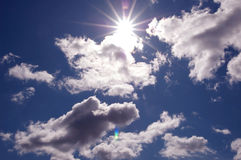 Sun streaming through the beautiful clouds Stock Images