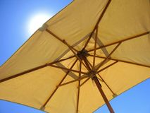 Sun stroke. Landscape photo of a large umbrella stock image