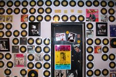 Sun Studio. A wall of old records and albums with poster ad pictures of Johnny Cash, Elvis, and Charlie Feathers inside the famous legendary rock n roll Memphis Royalty Free Stock Photography