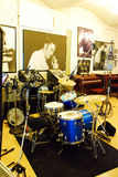 Sun Studios. A drum set in front of a photo of Elvis at Sun Studios, Memphis Tennessee royalty free stock photo