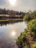 Sun sul fiume Fotografia Stock