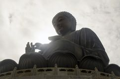 Sun sulla palma del ` s di Buddha Fotografie Stock