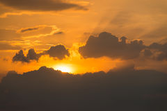 Sun and sunbeam behind clouds  light. Sun and sunbeam behind clouds golden light Stock Photo