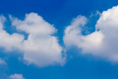 Sun with sunbeams in a beautiful cloudy sky. blue sky is covered by white clouds Stock Images
