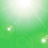 Sun and sunbeams. On a green background Royalty Free Stock Images