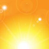 Sun and sunbeams. On orange background Royalty Free Stock Photos