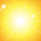 Sun and sunbeams. On orange background Royalty Free Stock Photo