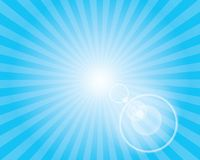 Sun Sunburst Pattern with lens flare. Blue sky. Stock Photography