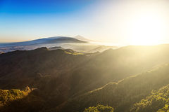 Sun with sunlight over mountains Royalty Free Stock Photo