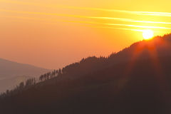 Sun at sunrise in the mountains Stock Photography