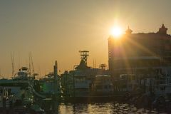 Sun At Sunset and Cityscape in a Torrid Day. Destin Beach, Florida royalty free stock photos