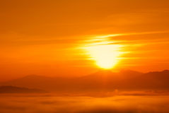 Sun at sunset with low fog Royalty Free Stock Photo