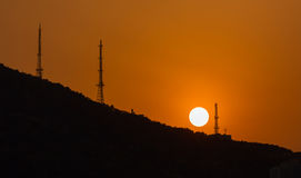 Sun during sunset over the hill Royalty Free Stock Photos