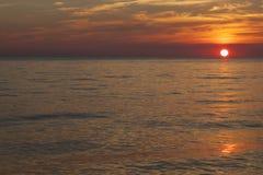 Sun am Sunset See Stockbild