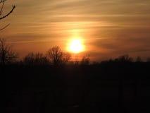 Sun at sunset village Tomasica 02.2017 Stock Photos