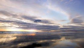 Sun surf pano clouds sky Royalty Free Stock Image