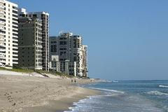 Sun surf, sand and condos on Singer Island Beach Stock Image