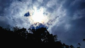 Sun surrounded by clouds Royalty Free Stock Photo