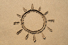 Sun symbol. A sun symbol drawn on a sandy beach Stock Images