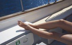 Sun tan on boat Royalty Free Stock Image