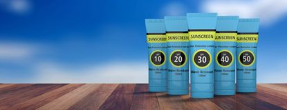 Sunscreen, sun protection lotion isolated on wooden deck, blue sky background. copy space, banner. 3d illustration. Sun tan protection. Sunscreen lotion tubes Royalty Free Stock Photo
