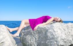 Sun tan on the rock Stock Photography