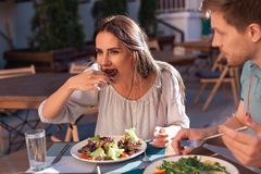 Sun tanned young woman enjoying eating salad Stock Photography