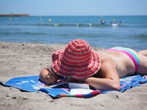 Sun Tanning, Beach, Body Of Water, Vacation Stock Photo