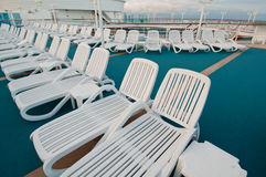 Sun tanning chairs on deck Royalty Free Stock Photography