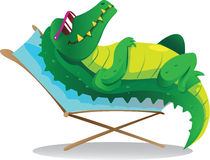 Sun tanning croc. Cool crocodile wearing eyeglasses sun tanning on beach chair Royalty Free Stock Image